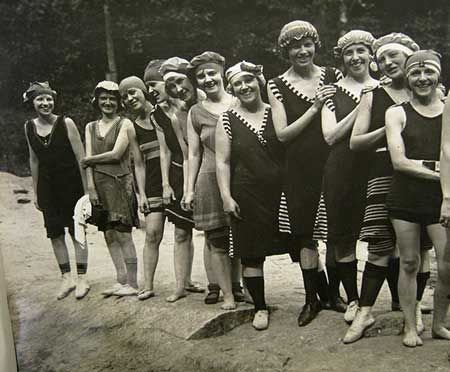 Camp Highland girls standing in line, wearing old-fashioned swimsuits